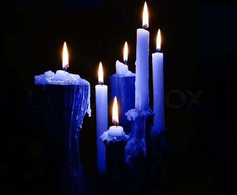 Blue Burning Candles On Black